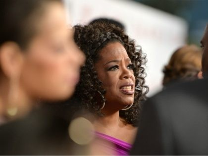 "LOS ANGELES, CA - AUGUST 12: Oprah Winfrey attends the Premiere Of The Weinstein Company's ""Lee Daniels' The Butler"" at Regal Cinemas L.A. Live on August 12, 2013 in Los Angeles, California. (Photo by Alberto E. Rodriguez/Getty Images)"