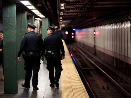 NEW YORK, NY - NOVEMBER 7: Members of the New York City Police patrol a subway station in Times Square, November 7, 2016 in New York City. With both presidential candidates holding their election night events in New York City, the NYPD has stepped up security ahead of election day. …