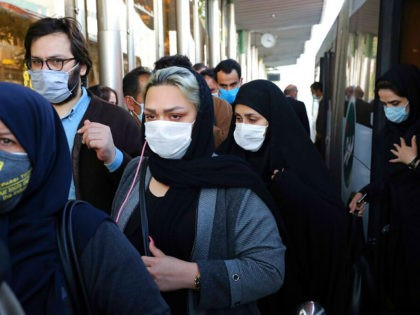 FILE - In this Sunday, Oct. 11, 2020 file photo, people wear protective face masks to help prevent the spread of the coronavirus in downtown Tehran, Iran. For the second day in a row, Iran announced Monday its highest single-day death toll from the coronavirus with 272 people killed. The …