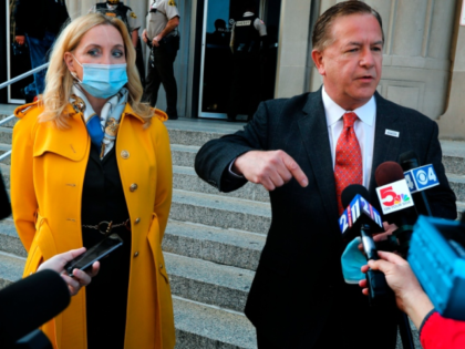 Mark McCloskey addresses the press alongside his wife Patricia on Tuesday, Oct. 6, 2020, outside the Carnahan Courthouse, in St. Louis, Mo. The couple's hearing scheduled for Tuesday was postponed until next week. The McCloskeys were charged in July with brandishing guns at protesters outside their Portland Place mansion in …