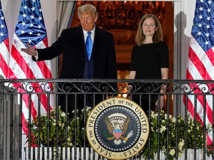 President Donald Trump and Amy Coney Barrett stand on the Blue Room Balcony after Supreme Court Justice Clarence Thomas administered the Constitutional Oath to her on the South Lawn of the White House White House in Washington, Monday, Oct. 26, 2020. Barrett was confirmed to be a Supreme Court justice …