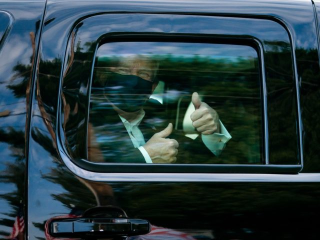 President Donald J. Trump greets supporters during a drive by outside of Walter Reed National Military Medical Center Sunday, Oct. 4, 2020, in Bethesda, Md. (Official White House Photo by Tia Dufour)