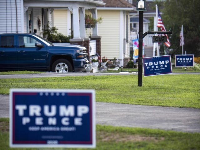 """""""Trump-Pence"""" signs and banners are seen on a street in Olyphant, just outside Scranton, Pennsylvania, on August 11, 2020. - It is not hard to miss the border between the industrial, mostly Democratic city of Scranton, Pennsylvania -- Joe Biden's hometown -- and its decidedly more right-leaning outskirts: amid all …"""