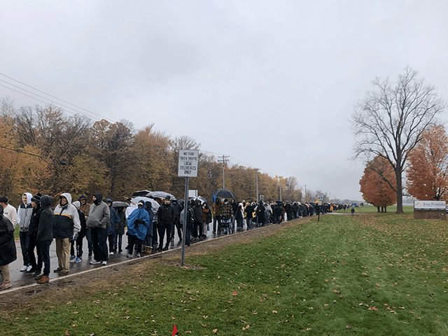 Great Lakes News shared this photo with Breitbart News, showing the line of attendees disappearing in the distance amid near-freezing temperatures