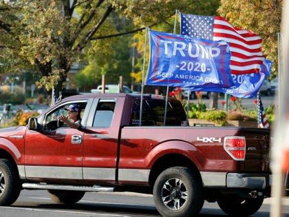 A President Donald Trump supporter drives the route of the motorcade carrying Vice President Mike Pence prior to the vice presidential debate Wednesday, Oct. 7, 2020, in Salt Lake City. (AP Photo/Jeff Swinger)