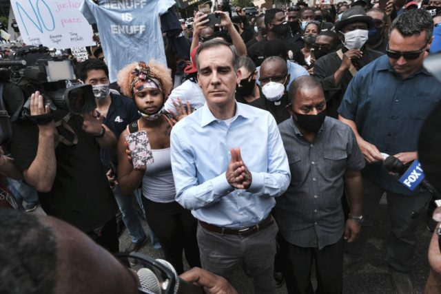 In this June 2, 2020, file photo, Los Angeles Mayor Eric Garcetti arrives to appeal to Black Lives Matter protesters in downtown Los Angeles. When Garcetti withdrew his support from District Attorney Jackie Lacey this week and endorsed her opponent, it was another blow to a campaign that has been …