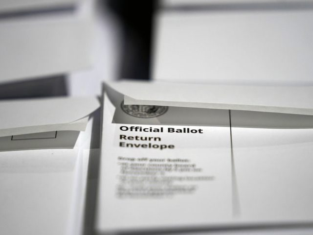 In this Thursday, Sept. 3, 2020, file photo, stacks of ballot envelopes waiting to be mailed are seen at the Wake County Board of Elections in Raleigh, N.C. Weeks from the election, three of North Carolina's most populous counties are often taking two weeks or more to send absentee ballots …