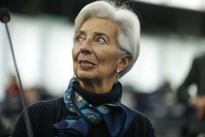 "In this Tuesday Feb. 11, 2020 file photo, Christine Lagarde president of the ECB looks up prior to deliver her speech before the European Parliament's economic and monetary affairs committee at the European Parliament in Strasbourg, France. The head of the European Central Bank says that the economic recovery ""risks …"