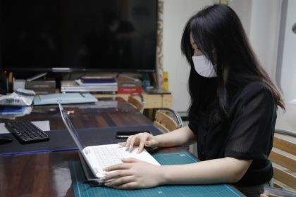 "Han Shin Bi, a high school senior in Seoul, demonstrates how to take online classes after an interview in Seoul, South Korea, on Sept. 18, 2020. ""Online classes were really inconvenient,"" said Han. Experts say the reduced interaction with teachers, digital distractions and technical difficulties are widening the education achievement …"