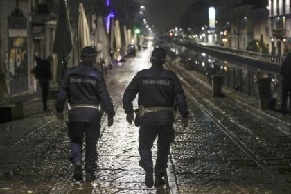 Two city police officers patrol the Navigli area, a popular evening spot of restaurants and pubs bordering canals in Milan, Italy, Thursday, Oct. 22, 2020. Authorities in regions including Italy's three largest cities have imposed curfews in a bid to slow the spread of COVID-19, as many of the cases …