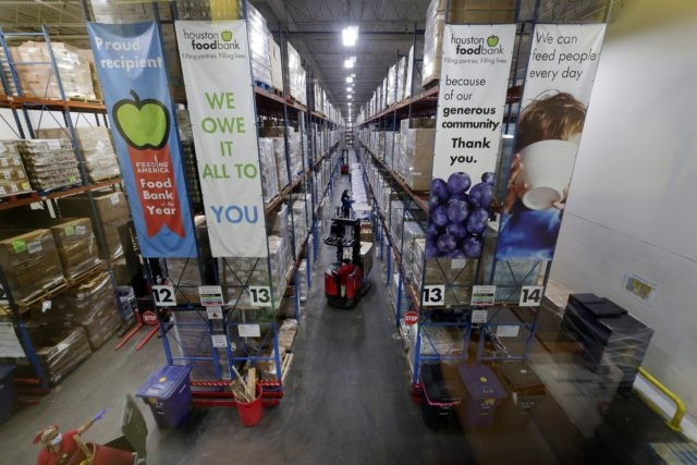 Pallets of various foods are stacked on shelves in the extensive warehouse at the Houston Food Bank Wednesday, Oct. 14, 2020, in Houston. It's the largest U.S. food bank and national food bank leaders say they don't see an end in sight to the demand. (AP Photo/Michael Wyke)