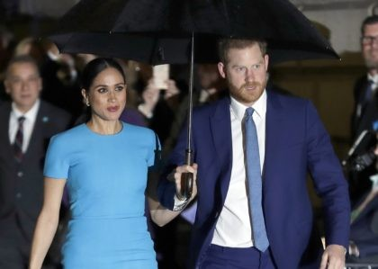 In this March 5, 2020 file photo, Britain's Prince Harry and Meghan, the Duke and Duchess of Sussex arrive at the annual Endeavour Fund Awards in London. Britain's Prince Harry says it took him many years and the experience of living with his wife, the former Meghan Markle, to understand …