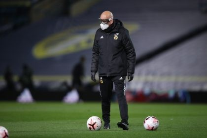 A Leeds United's assistant coach, name not available, wearing protective goggles and a mask, to help prevent the spread of coronavirus, helps players to warm up prior to the English Premier League soccer match between Leeds United and Wolverhampton Wanderers at Elland Road ground in Leeds, England, Monday, Oct. 19, …
