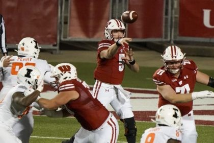 Wisconsin quarterback Graham Mertz throws a pass during the first half of an NCAA college football game against Illinois Friday, Oct. 23, 2020, in Madison, Wis. (AP Photo/Morry Gash)