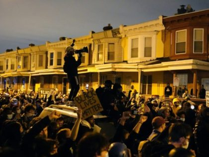 Protesters confront police during a march Tuesday Oct. 27, 2020 in Philadelphia. Hundreds of demonstrators marched in West Philadelphia over the death of Walter Wallace, a Black man who was killed by police in Philadelphia on Monday. Police shot and killed the 27-year-old on a Philadelphia street after yelling at …