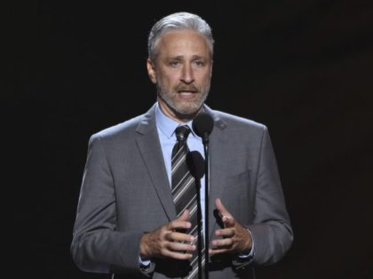 Jon Stewart presents the Pat Tillman award for service on July 18, 2018, at the ESPY Awards in Los Angeles. Stewart will return to television as host of an Apple TV+ public affairs show, the streaming service said Tuesday, Oct. 27, 2020. (Photo by Phil McCarten/Invision/AP, File)