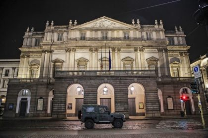 In this early Sunday, Oct. 25, 2020 file photo, A military vehicle drives past La Scala opera theater in Milan, northern Italy. The number of performers at Milan's famed La Scala opera house positive with the coronavirus has risen to 21, even as the theater was forced to close due …