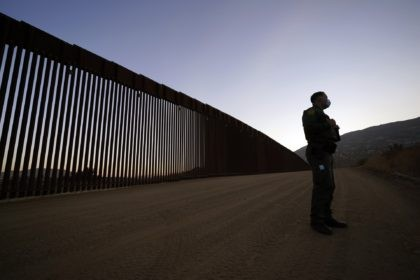 Border Patrol agent Justin Castrejon speaks in front of newly replaced border wall sections Thursday, Sept. 24, 2020, near Tecate, Calif. Top Trump administration officials will visit South Texas five days before Election Day to announce they have completed 400 miles of U.S.-Mexico border wall, attempting to show progress on …