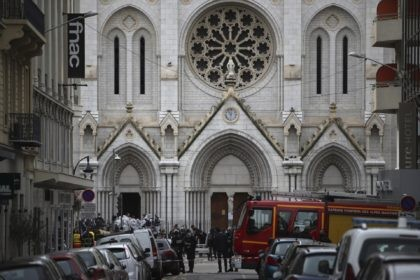 French policemen and forensic officers stand in front of Notre Dame church after a knife attack, in Nice, France, Thursday, Oct. 29, 2020. French anti-terrorism prosecutors are investigating a knife attack at a church in the Mediterranean city of Nice that killed two people and injured several others. (AP Photo/Daniel …