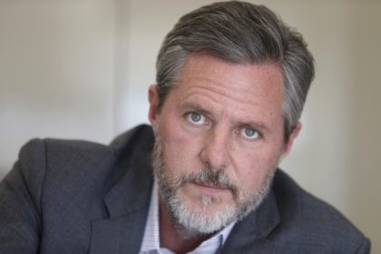 In this Nov. 16, 2016 file photo, Liberty University president Jerry Falwell Jr., poses during an interview in his offices at the school in Lynchburg, Va. Falwell filed a lawsuit Wednesday, Oct. 28, 2020, against Liberty University with defamation and breach of contract claims alleging the school damaged his reputation …