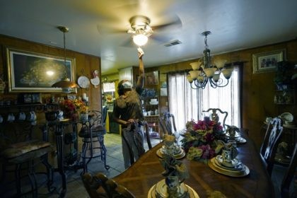 Birdia Williams turns on her ceiling fan, Thursday, Oct. 22, 2020, to help cool the house she and her husband, John Williams, purchased 23 years earlier in Itta Bena, Miss., a few blocks from what was then a busy downtown. Now, the couple, living on a fix income as retirees, …
