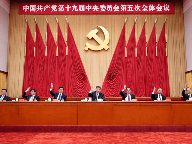 In this photo released by Xinhua News Agency, Chinese President Xi Jinping, also general secretary of the Communist Party of China (CPC) Central Committee, leads other Chinese leaders attending the fifth plenary session of the 19th Central Committee of the Communist Party of China (CPC) in Beijing, China on Oct. …