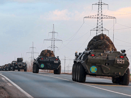 This photo made from the footage provided by Russian Defense Ministry press service on in Tuesday, Nov. 10, 2020 shows Russian military vehicles carry peacekeepers on their way to an airport in unknown place in Russia. Scores of Russian peacekeepers were heading to Nagorno-Karabakh on Tuesday morning, hours after Armenia …