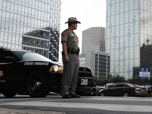 A Texas state trooper stands at a roadblock in Dallas. (AP Photo/Eric Gay)