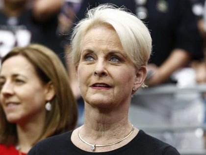 Cindy McCain, wife of the late U.S. Sen. John McCain, stands on the sidelines prior to an NFL football game between the Washington Redskins and the Arizona Cardinals, Sunday, Sept. 9, 2018, in Glendale, Ariz. (AP Photo/Ross D. Franklin)