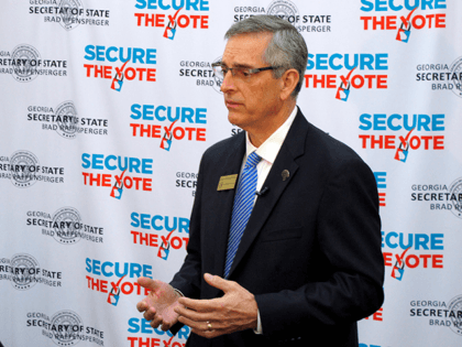 Georgia Secretary of State Brad Raffensperger speaks with a reporter at a conference of local election officials in Savannah, Ga., Wednesday, Dec. 11, 2019. Raffensperger told about 700 local officials who are preparing to rollout new voting machines statewide to expect more than 1 million additional voters at the polls …