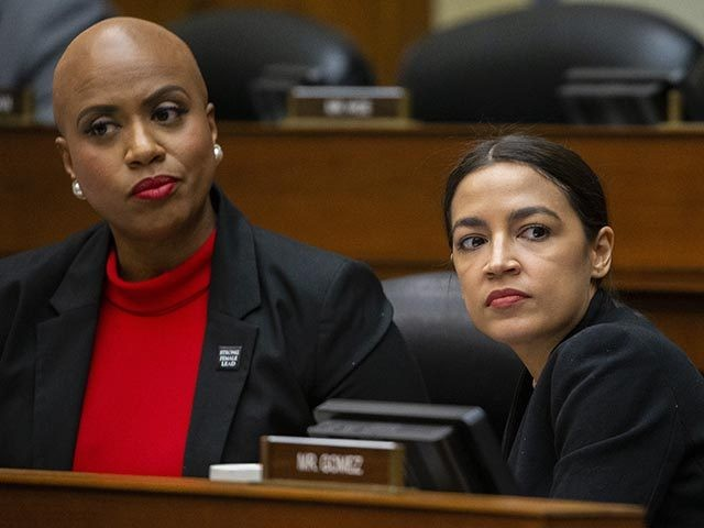 Rep. Ayanna Pressley, D-Mass., left, and Rep. Alexandria Ocasio-Cortez, D-N.Y., listen as U.S. Census Bureau Director Steven Dillingham testifies during a hearing of the House Committee on Oversight and Reform, on Capitol Hill, Wednesday, Feb. 12, 2020, in Washington. (AP Photo/Alex Brandon)