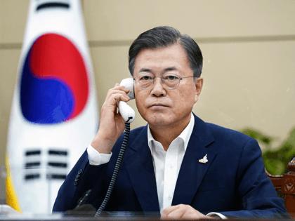 In this photo provided by South Korea Presidential Blue House, South Korean President Moon Jae-in talks on the phone with Japanese Prime Minister Yoshihide Suga at the presidential Blue House in Seoul, South Korea, Thursday, Sept. 24, 2020. Suga on Thursday held his first telephone call with his South Korean …