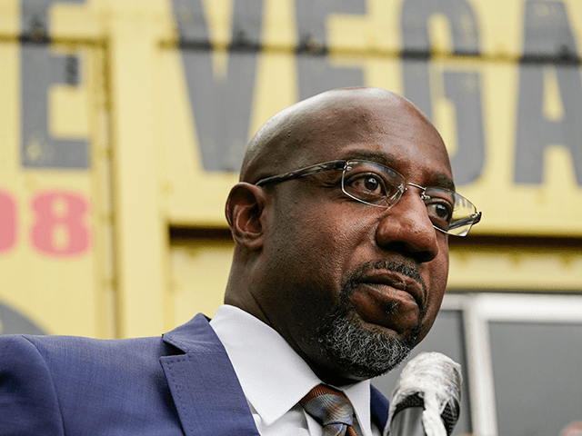 "Democratic candidate for Senate Raphael G Warnock speaks to a crowd during a ""Get Out the Early Vote"" event at the SluttyVegan ATL restaurant on Tuesday, Oct. 27, 2020, in Jonesboro, Ga. (AP Photo/Brynn Anderson)"