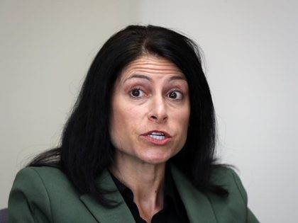 FILE - In this June 4, 2019, file photo, Michigan Attorney General Dana Nessel listens to a question from reporters in Detroit. On Tuesday, Oct. 27, 2020, a judge blocked a sudden ban on the open display of guns near Michigan polling places on Election Day. Gun-rights groups said Secretary …
