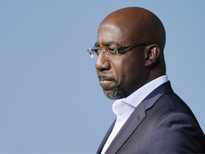 Raphael Warnock, a Democratic candidate for the U.S. Senate, speaks to Biden supporters as they wait for former President Barack Obama to arrive and speak at a rally as he campaigns for Democratic presidential candidate former Vice President Joe Biden, Monday, Nov. 2, 2020, at Turner Field in Atlanta. (AP …