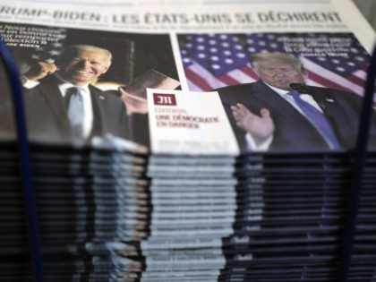 "A pile of French newspaper Le Monde headlines ""Trump-Biden : the United States is tearing itself apart, Editorial : a democracy in danger"" about the U.S. presidential elections, at a newspapers stand in Paris, Wednesday, Nov. 4, 2020. The world is watching as millions of Americans cast their ballots for …"