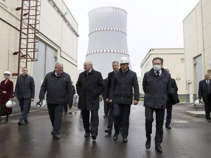 FILE - In this Saturday, Nov. 7, 2020 file photo, Belarusian President Alexander Lukashenko, center left, visits the first Belarusian Nuclear Power Plant during the plant's power launch event outside the city of Astravets, Belarus. Belarus' first nuclear power plant stopped generating electricity the day after it was formally opened …