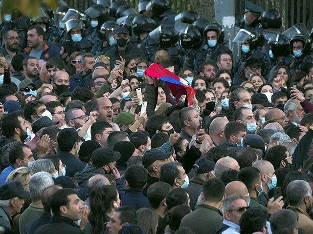 Protesters gather near the parliamentary building during a protest against an agreement to halt fighting over the Nagorno-Karabakh region, in Yerevan, Armenia, Wednesday, Nov. 11, 2020. Thousands of people flooded the streets of Yerevan once again on Wednesday, protesting an agreement between Armenia and Azerbaijan to halt the fighting over …