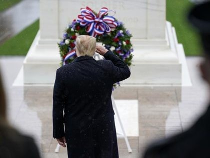 President Donald Trump salutes as he participates in a Veterans Day wreath laying ceremony at the Tomb of the Unknown Soldier at Arlington National Cemetery in Arlington, Va., Wednesday, Nov. 11, 2020. (AP Photo/Patrick Semansky)
