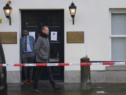 Bullet impacts are seen in the windows of Saudi Arabia's embassy in The Hague, Netherlands, Thursday, Nov. 12, 2020, after several shot were fired at the building early in the morning. Nobody was injured and police were investigating. (AP Photo/Mike Corder)