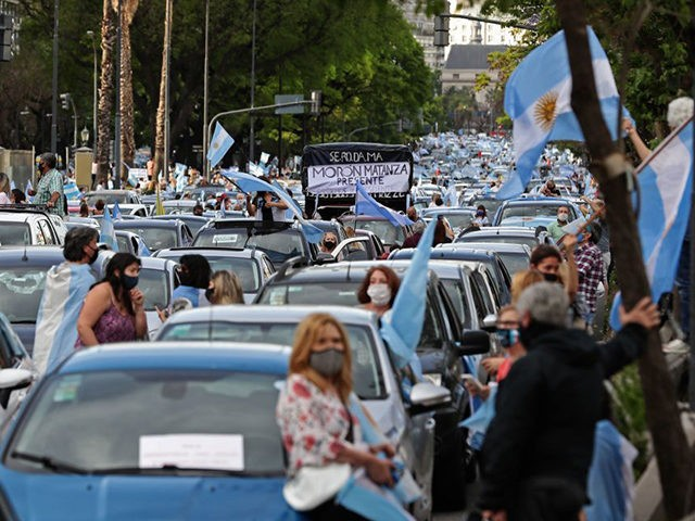 People take part in a protest against the government of Argentina's President Alberto Fernandez at Plaza de la Republica square in Buenos Aires on November 8, 2020, amid the recent new phase of social distancing against the spread of the COVID-19 coronavirus. - Thousands demonstrated against the government, summoned by …