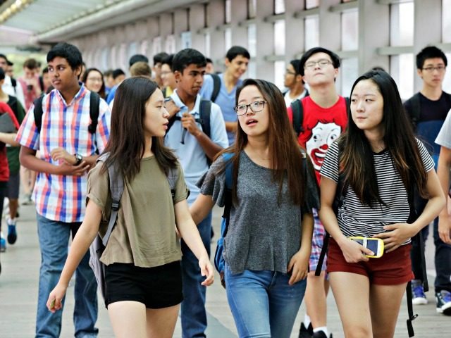 In this Sept. 9, 2015 file photo, students arrive for the first day of school at Stuyvesant High School in New York. A push to diversify New York City's most elite public high schools is facing a backlash from the group that makes up most of the schools' current student …