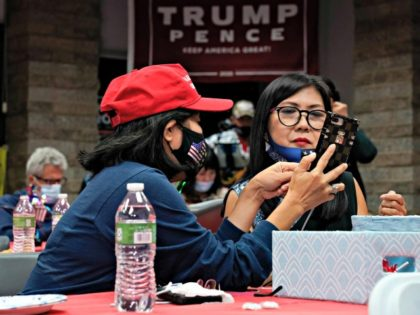 Stephanie Nguyen, left, and Michelle Do wait for election results with other supporters of President Donald Trump Tuesday, Nov. 3, 2020, in Stanton, Calif. (AP Photo/Ashley Landis)