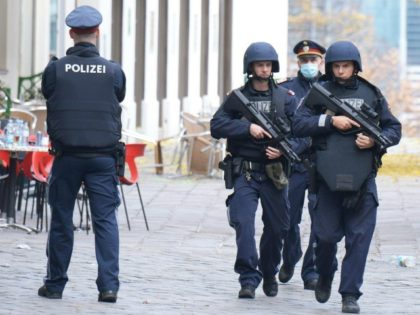 Policemen patrol on November 3, 2020 close to a crime scene in Vienna after a shooting. - A huge manhunt was under way Tuesday, November 3, 2020 after gunmen opened fire on November 2, 2020 at multiple locations across central Vienna, killing at least four people in what Austrian Chancellor …