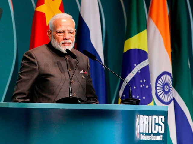 India's Prime Minister Narendra Modi speaks during the BRICS Business Council prior to the 11th edition of the BRICS Summit, in Brasilia, on November 13, 2019. - Bolsonaro walked a diplomatic tightrope, as he seeks to boost ties with Beijing and avoid upsetting key ally Donald Trump, on the eve …