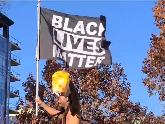 A man in Madison, Wisconsin, dances with an effigy of a beheaded Donald Trump. (Twitter Video Screenshot/Rebecca Brannon)