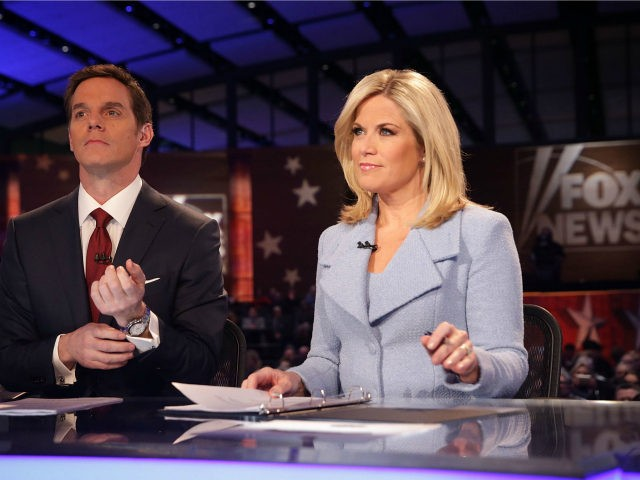 Moderators Martha MacCallum (R) and Bill Hemmer (L) wait for the beginning of the first forum of the Fox News - Google GOP Debate January 28, 2016 at the Iowa Events Center in Des Moines, Iowa. Residents of Iowa will vote for the Republican nominee at the caucuses on February …