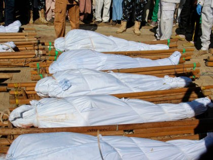 The bodies of 43 farm workers are seen during a funeral in Zabarmari, about 20km from Maiduguri, Nigeria, on November 29, 2020 after they were killed by Boko Haram fighters in rice fields near the village of Koshobe on November 28, 2020. - The assailants tied up the agricultural workers …