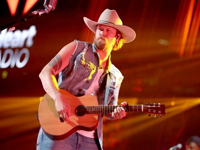 AUSTIN, TX - MAY 04: (EDITORIAL USE ONLY. NO COMMERCIAL USE) Brian Kelley of Florida Georgia Line performs onstage during the 2019 iHeartCountry Festival Presented by Capital One at the Frank Erwin Center on May 4, 2019 in Austin, Texas. (Photo by Rich Fury/Getty Images for iHeartMedia)