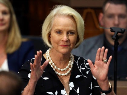 In this Jan. 13, 2020, file photo Cindy McCain, wife of former Arizona Sen. John McCain, waves to the crowd after being acknowledged by Arizona Republican Gov. Doug Ducey during his State of the State address on the opening day of the legislative session at the Capitol in Phoenix. Democratic …